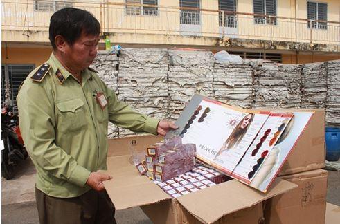 Những hộp mỹ phẩm chăm sóc tóc của Trung Quốc nhưng ghi rõ cụ thể địa chỉ sản xuất tại VN bị cơ quan chức năng phát hiện.